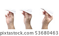 Hand holding a paper plane isolated on white 53680463
