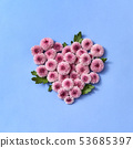 Flowering heart from chrysanthemum on a pastel background. 53685397