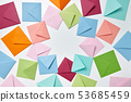 Colorful frame from empty handmade envelopes on a light background. 53685459