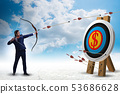 Businessman aiming arrow with bow 53686628