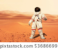 Man in a space suit standing on the red planet 53686699