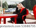Stylish beautiful woman in a black coat  53686795