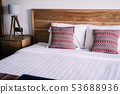 Bedroom interior, light wooden bedhead 53688936