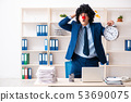Young clown businessman working in the office  53690075