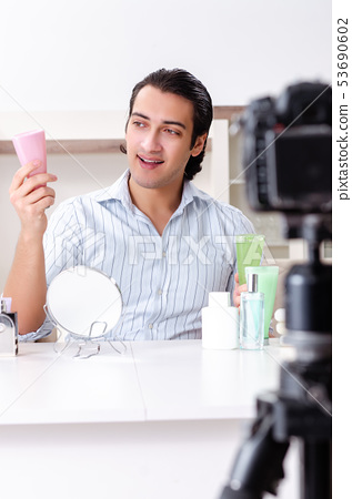 Young handsome man recording his blog in hygiene concept  53690602