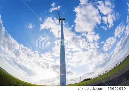Wind turbines against blue sky during sunrise 53691059