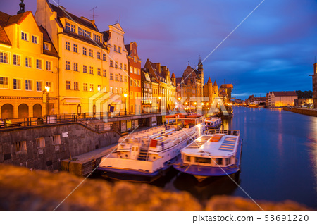 Downtown of Gdansk with boats in harbor during 53691220
