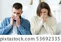 Flu Concept. Couple Blowing Noses In Tissues At Home 53692335