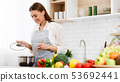 Happy Woman Cooking Dinner In Kitchen, Stiring Soup 53692441