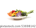 Assort fresh fruits and vegetables in dish 53698142