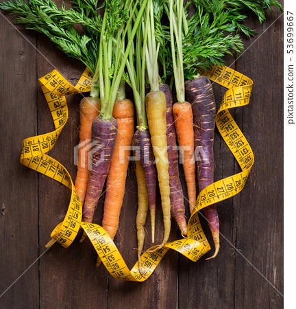 Fresh organic rainbow carrots and yellow measuring 53699667