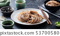 Soba noodles with sauce and green tea set. Japanese food. Black slate background. 53700580