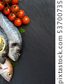 Fresh fish and tomatoes 53700735