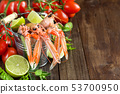 Raw langoustine in a bucket with vegetables 53700950