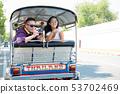 Young couple tourists on Tuk Tuk taxi in Bangkok 53702469