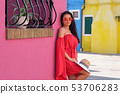 Young Tourist Woman In Old Italian colorful Town 53706283