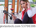 Sport  pretty woman listens to music in headphones 53706386