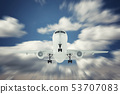 Airplane in the sky above the clouds 53707083