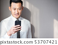Asian businessman use cellphone 53707421
