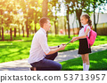 father leads daughter to school in first grade. first day at school. back to school 53713957