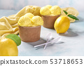 two portions lemon ice cream in paper cup and 53718653
