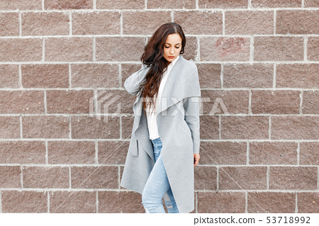 Young stylish woman in trendy coat posing  53718992