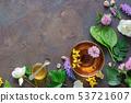 Glass mug of herbal tea, medicinal herbs. Top view 53721607