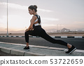 Stretching on road in tropical country of joyful beautiful woman in sunny morning. Training of 53722659