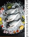 Fresh raw dorado fish and food ingredients on table 53726618