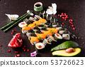 Rainbow Sushi set with salmon, eel, tuna, avocado, royal prawn, cream cheese Philadelphia, caviar tobica, chuka. Sushi menu. Japanese food 53726623