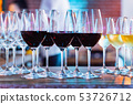 Wine glasses on white background in bright lights 53726712