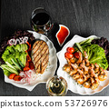 grilled shrimps and salmon steak with fresh vegetables and wine 53726976