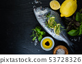 Raw fish with herbs and spices 53728326