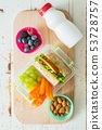 Making school lunch on wood background 53728757