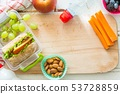Making school lunch on wood background 53728859
