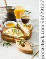 Toasts with pear, goat cheese and walnuts, honey, rosemary 53729127