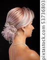 Close up portrait of stylish coiffure on beautiful blonde woman on studio background 53736803