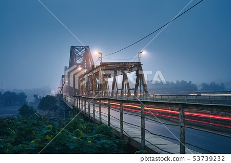 Bridge in mysterious fog 53739232
