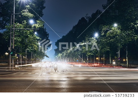 Light trails of traffic in city 53739233