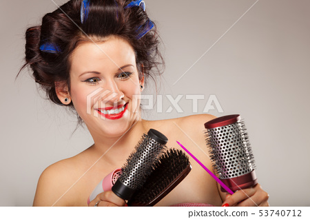 funny girl styling hair holds many accessories 53740712