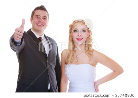 Happy groom and bride posing for marriage photo 53740930