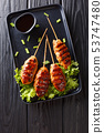 Tsukune Japanese chicken meatballs, skewered and 53747480