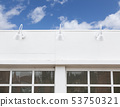Blank Building Front With Lamps and Windows 53750321