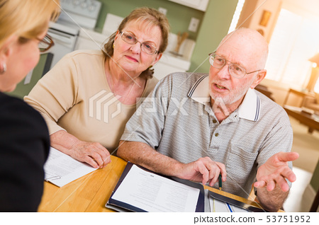 Senior Adult Couple Signing Documents with Agent 53751952