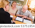 Senior Adult Couple Signing Documents with Agent 53751954