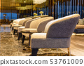 Interior room with row of modern armchairs on marble floor. 53761009