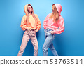 Two hipster Girl Having Fun in Stylish neon Outfit 53763514