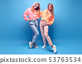 Two hipster Girl Having Fun in Stylish neon Outfit 53763534