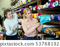Two girls choosing fabric in store 53768192