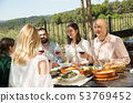 Friends having lunch on the open-air terrace 53769452